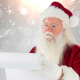 Santa Claus reading a list on a scroll. The background is grey with snowflakes.